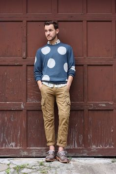 Shop this look on Lookastic:  http://lookastic.com/men/looks/grey-long-sleeve-shirt-blue-crew-neck-sweater-khaki-cargo-pants-dark-brown-brogues/9588  — Grey Print Long Sleeve Shirt  — Blue Polka Dot Crew-neck Sweater  — Khaki Cargo Pants  — Dark Brown Leather Brogues