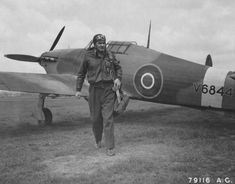 American pilot Loren Boyd Hillsinger walks away from his Hawker Hurricane after landing at Hendon Field, England.  Hillsinger was the first pilot to return to flying duty after losing a leg.