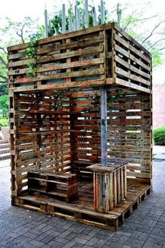 Outdoor bar or place for grill made from pallets joined together to almost form an outdoor room.