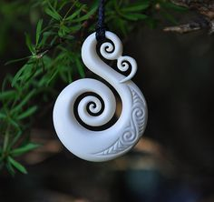 Handcarved Bone  Koru  by JackieTump on Etsy.....LOVE IT!!