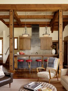 Cabin or ski lodge. Luv the pop of red and metal w distressed wood.
