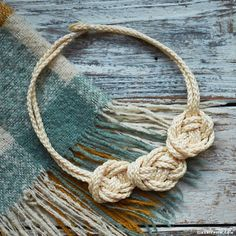 Follow our easy step-by-step photo tutorial to craft your own macrame knot necklace that fashionably pairs with any outfit during any season
