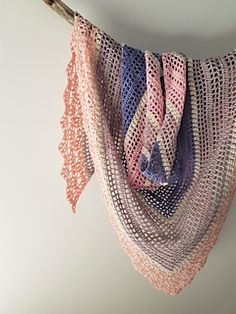 Symphony was designed to be light, gentle and romantic. Made with Kaleidoscope's MyAngel, a 100% light fingering weight cotton, this shawl will sit lightly on your shoulders.
