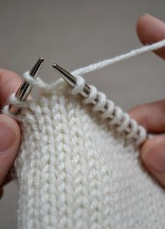 "Short Rows tend to strike fear into the hearts of the uninitiated, but, like all knitting, there's really nothing so mysterious about it. Short Rows are used to create triangles or wedges within your knitting. They shape everything from bust darts to ear flaps. Basically, a Short Row is just that: a row that you don't knit to the end of the needle. Instead, you work part of the way across the row, do something called a ""wrap and turn"", and then work back the other way, sometimes to the end…"