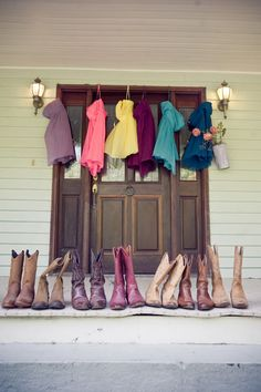 All the bridesmaids' cowgirl boots lined up in a row.