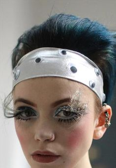 Pretty Disturbia Silver Eyeball Embellished Headband. Selling for £2.50.