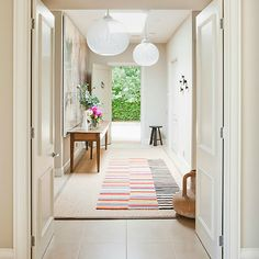 sunlit entrance with a contemporary rug