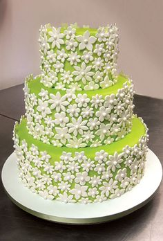 Outstanding Wedding Cake. So many flowers and each different cut and shape. Love the lime green.