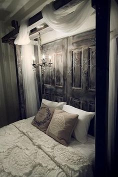 Bedroom - maybe not this rustic...but good idea with chandelier above bed & and doors as visual weight behind bed