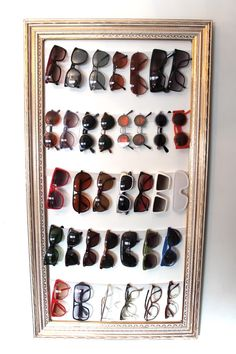 Easy DIY Framed sunglasses holder for closet. Using thick elastic to hold the sunglasses. This one looks easier no sewing required. Think I will make two smaller versions of these instead.