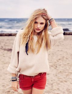 Red shorts and a chunky sweater