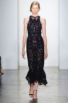And speaking of occasion dressing, a fit and flare, high neck, macramé gown with peek a boo detail was a subtle stunner.   - HarpersBAZAAR.com