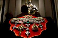 "A necklace of Saint Januarius, in gold, silver and precious stones created by Michele Dato in 1679, is displayed during the press day of the exhibition ""The Treasure of Naples"", in Rome, Italy. Riches from a Neapolitan treasure trove said to be worth more than the British crown jewels are going on show in Rome in an unprecedented exhibition of emeralds and diamonds once owned by popes and kings. Photograph: Gabriel Bouys/AFP/Getty Images"