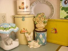 Vintage tins & canisters repurposed in  laundry room. by sweetcottagedreams, via Flickr