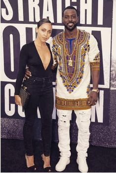 """Lance Gross and his gorgeous wife were one fly couple at the """"Straight Outta Compton"""" movie premiere. The actor paired his white jeans and Jesus piece chain with a West African tunic for a cool summer look."""