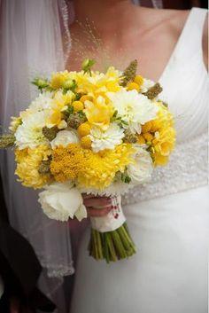 Inspired Floral Design; craspedia, snapdragons, roses, freesia, solidago, rosemary and scented geranium bound with burlap.