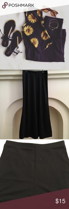 Uniqlo Skirt Size XS, can fit S but a little snug. Black color. A little stretchy. Waist has slight stretch elastic. Length of skirt is 33in. Maxi style. Slight mermaid look at the bottom. Soft. Worn once. Uniqlo Skirts Maxi