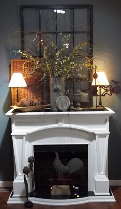 Fireplace Decor - I really like the greenery on the mantle, smack dab in the middle.....