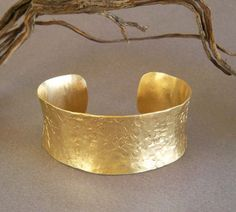 My indie designed handmade bracelet is a favorite of Grammy Award Winner, Miranda Lambert! Featured in Glamour Magazine December 2014 (see photo 2 above). This gold tone cuff bracelet is inspired by ancient Egyptian and Greek jewelry designs. I construct this cuff in solid brass, hammering and molding it into subtle organic curves, using the same handmade methods from ancient times. The result is a golden wrist adornment, looking as if its been unearthed from a long lost treasure chest…