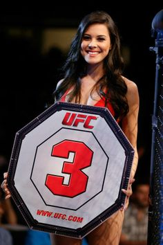 UFC Octagon Girl Camila Rodrigues de Oliveira introduces a round that had barely been used.