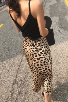 This silk leopard midi skirt from Réalisation Par is the biggest fashion trend on Instagram right now #skirts