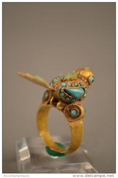 A Gold Bird Ring circa 600-400 B.C Gold Ring with Inlaid Termini in the Form of Seated Bird.