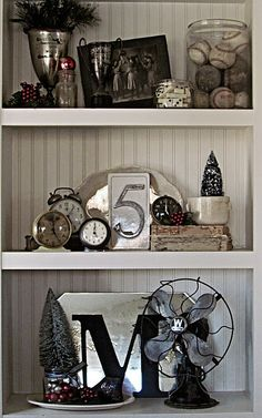 I love the vintage masculine feel to this vignette...vintage fan, collection of dominoes, baseballs, and clocks