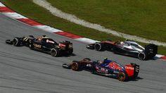 Carlos Sainz jr (ESP) Scuderia Toro Rosso STR10, Romain Grosjean (FRA) Lotus E23 Hybrid and Jenson Button (GBR) McLaren MP4-30 at Formula One World Championship, Rd2, Malaysian Grand Prix, Race, Sepang, Malaysia, Sunday 29 March 2015. © Sutton Motorsport Images