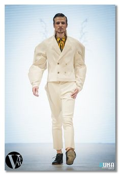 Launching his first collection at Vancouver Fashion Week was Mario Young who's luxury menswear collection was masculine with a strong emphasis on broad shoulders and toned muscles, something a superhero would wear on weekends when not saving the world.