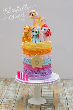 My Little Pony cake, i would probably use the little MPL plastic toys instead of making the actual ponies.