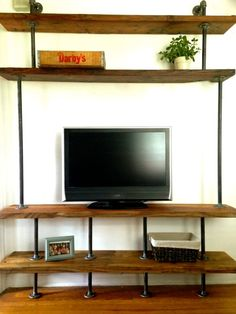 Industrial entertainment center diy stand pipe pin by simplified building on industrial pipe shelves industrial pipe Furniture, Home, Wall Shelving Units, Industrial Entertainment Center, Furniture Decor, Entertaining Decor, Entertainment Center, Diy Garden Furniture, Entertaining House