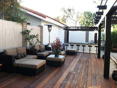 Redwood deck with comfortable outdoor seating, pergola and elaborate outdoor kitchen designed by Windsor Decks and Gardens.