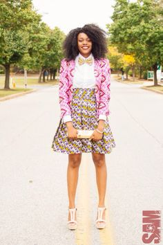 Mixed prints are always welcome! Great styling with the bow tie #africanprint #style