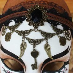 The #steampunk #necklace detail on the Ophelia Bates-Harvard mask. It can be removed and worn.