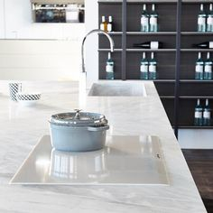 'Fly' Kitchen by MODULNOVA. As shown in stunning 'Elba' natural stone @artedomus & featuring white ceramic SmartSense Plus induction cooktop @smegaustralia.