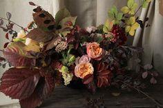 Rustic peach fall centerpiece idea by Sarah Winward