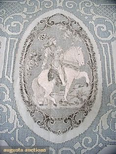 """Augusta Auctions...APPENZELL GRAND TOUR BANQUET CLOTH, c. 1910....White linen w/ embroidery on drawn-work ground, European landmark catouches alternating w/ knights on horseback, no repeating motifs, bordered by rose vines & scrollwork, 70"""" x 140"""", t/w 12 matching embroidered 22"""" dinner napkins, pristine."""