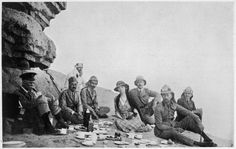 Gertrude Bell, a British writer, archaeologist, and colonial administrator, is best known for her role in establishing the modern state of Iraq after World War I. In this 1922 photograph Bell dines with British and Iraqi officials in the desert.
