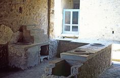 Behind the counter. Thermopolium. Pompeii by ClydeHouse, via Flickr