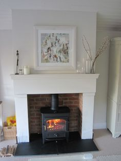 Clearview Vision 500 in metallic black with black sandstone hearth set in a calm, light, airy and happy Edwardian Villa in Rowledge, Farnham, Surrey. Wood Burner Fireplace, Fireplace Hearth, Home Fireplace, Living Room With Fireplace, Fireplace Surrounds, Fireplace Design, My Living Room, Home And Living, Living Room Decor