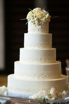 A five-tier cake with a hand-piped design and floral topper {Mark Davidson Photographer}