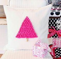 Make a pom pom pillow with a fabric glue and pom poms. Easy gift idea and fun way to decorate for Christmas. Complete instructions on how to make it.