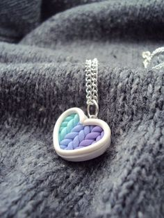 Items similar to Ombre Teal Purple Knitted Heart Necklace Polymer Clay, Miniature Clay Jewelry, Silver Plated Chain on Etsy I mixed different shades of polymer clay to achieve an ombre look between 2 different colors. A knitted heart to keep yo. Cute Polymer Clay, Cute Clay, Polymer Clay Miniatures, Polymer Clay Necklace, Fimo Clay, Polymer Clay Projects, Polymer Clay Charms, Polymer Clay Creations, Clay Crafts