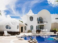 Influenced by the mountains of seashells around the home, Casa Caracol or The Seashell House in Mexico goes for $225/night. The unique home's living area consists of one large and small seashell overlooking the Carribean Sea. See the full listing here.  Courtesy Airbnb.com  - HouseBeautiful.com