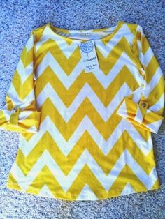 Silky chevron blouse from Our World Boutique. http://momsthumb.blogspot.com/2013/09/stylish-blouse.html