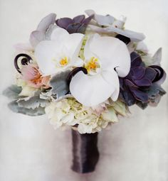 Gorgeous bouquet with orchids, succulents, dusty miller and more! By The Hidden Garden