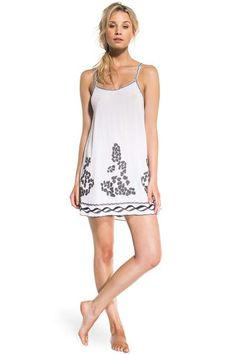 Elegant and effortless, this mini dress is such an easy thing to put on when you're in hurry to go to the beach. Made of silk and crinkle and designed to fit any body type, you will love its casual feel. Front and bottom of the dress are embroidered with an organic and sophisticated grey pattern. Highlighted by a dark grey embroidery, the two fine shoulders straps are revealing an elegant shoulder line and nice silhouette at the back.
