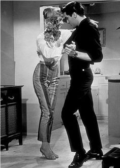 I love the dance posture of Elvis in this image.