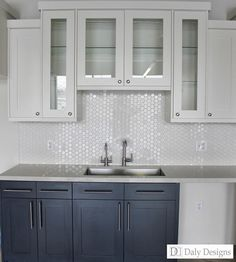 honeycomb tile - white upper cabinets, colored lower cabinets.