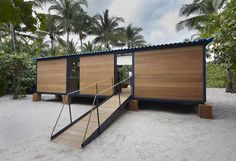 iously unrealised beach house designed by modernist architect Charlotte Perriand in 1934 has been constructed and furnished by French fashion house Louis Vuitton to coincide with this year's Design Miami fair (+ slideshow). Miami Beach House, Tiny Beach House, Tiny House, Beach Houses, Charlotte Perriand, Casas Containers, Famous Architects, Louis Vuitton, House Built